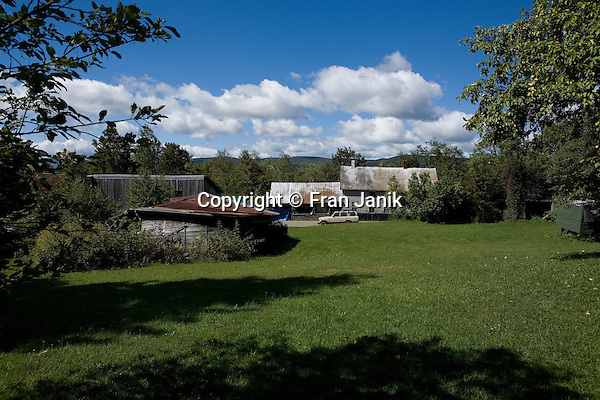 A dairy farmers house and out buildings are captured on a sunny day in Eden Vermont. The town of Eden is located in northen Vermont near Stowe and Jay Peak.