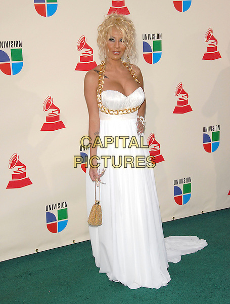 IVY QUEEN.The 8th Annual Latin Grammys held at The Mandalay Bay Hotel & Casino in Las Vegas, California, USA..November 8th, 2007.full length white dress gold chain halterneck tattoos cleavage nails fake long bag purse .CAP/DVS.©Debbie VanStory/Capital Pictures