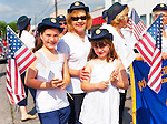 American Legion Auxiliary members Sharon Williams and her granddaughters Madison and Jacqueline marching at Merrick Memorial Day Parade and Ceremony on May 28, 2012, on Long Island, New York, USA. Their Merrick Post 1282 hosted the parade and ceremony. America's war heroes are honored on this National Holiday.