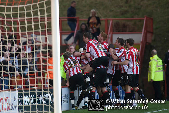 Sheffield United 2 Leeds United 0, 19/03/2011. Bramall Lane, Championship. Sheffield United players in front of the Kop Stand celebrating the second goal of the game, scored by substitute Bjorn Helge Riise during the second half of the Npower Championship fixture with Leeds United. The home team won the game by two goals to nil watched by a crowd of 23,728. Bramall Lane is the world's oldest professional football ground and at one time hosted both football and cricket. Photo by Colin McPherson.