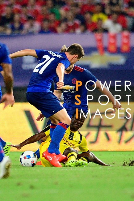 Manchester United midfielder Ander Herrera (l) trips up with Borussia Dortmund striker Adrian Ramos (r) during the International Champions Cup China 2016, match between Manchester United vs Borussia  Dortmund on 22 July 2016 held at the Shanghai Stadium in Shanghai, China. Photo by Marcio Machado / Power Sport Images
