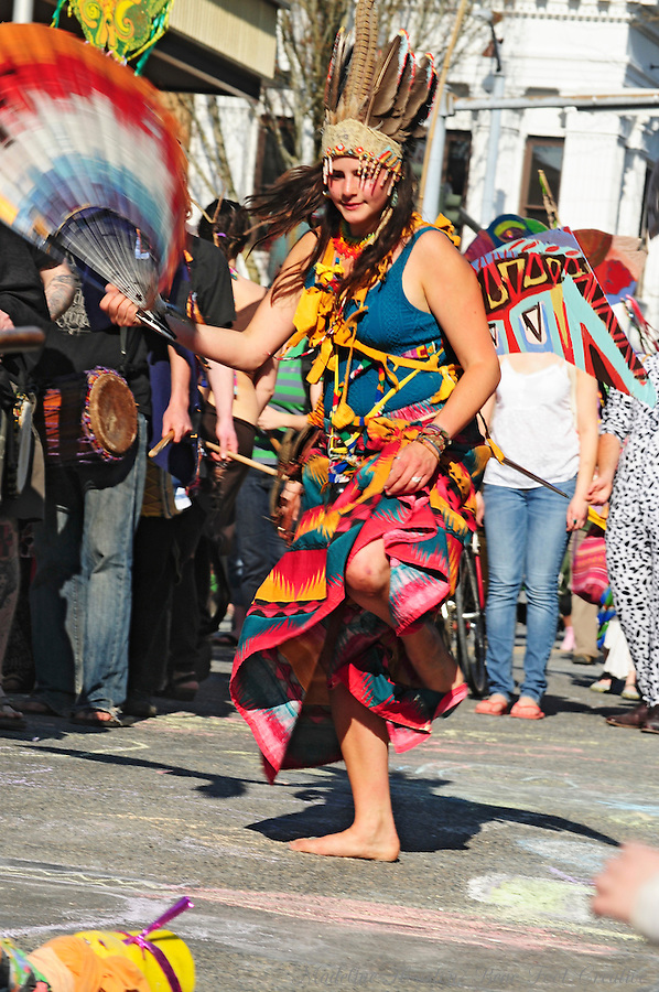 A participant in the Procession of the Species dances down the street in Olympia, Washington's Earth Day celebration.