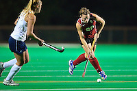 STANFORD, CA - OCTOBER 21, 2011: Redshirt Junior Devon Holman weaves past a defender during the game between Stanford field hockey and UC Davis at the Varsity Field Hockey Turf in Stanford, California on October 21, 2011.  Stanford defeated UC Davis, 5-0.