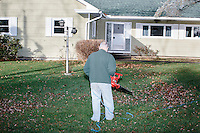 A man uses a leafblower on his lawn in Nashua, New Hampshire. Volunteers for Kentucky senator and Republican presidential candidate Rand Paul were canvassing the neighborhood.