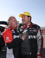 Apr. 7, 2013; Las Vegas, NV, USA: NHRA funny car driver Cruz Pedregon celebrates with a crew member after winning the Summitracing.com Nationals at the Strip at Las Vegas Motor Speedway. Mandatory Credit: Mark J. Rebilas-