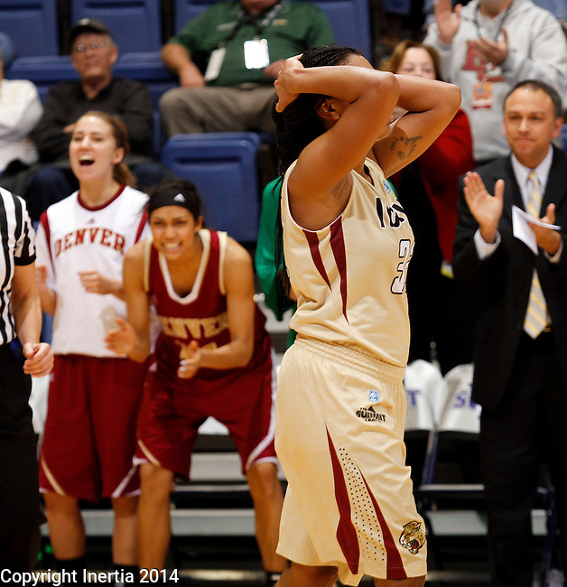 SIOUX FALLS, SD - MARCH 10:  Dawn Luster #32 from IUPUI holds her head as the Denver bench celebrates a foul late in overtime of their semifinal game at the 2014 Summit League Basketball Championships Monday at the Sioux Falls Arena(Photo by Dave Eggen/Inertia)