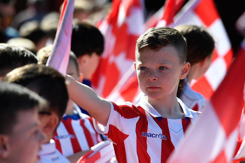 A young fan carries a flag at the Britannia Stadium, home of Stoke City<br /> <br /> Photographer Terry Donnelly/CameraSport<br /> <br /> The Premier League - Stoke City v Liverpool - Saturday 8th April 2017 - bet365 Stadium - Stoke-on-Trent<br /> <br /> World Copyright &copy; 2017 CameraSport. All rights reserved. 43 Linden Ave. Countesthorpe. Leicester. England. LE8 5PG - Tel: +44 (0) 116 277 4147 - admin@camerasport.com - www.camerasport.com