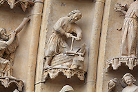 Noah building the ark, on one of the left-hand archivolts of the tympanum of the South portal or St Honore portal on the South transept of the Basilique Cathedrale Notre-Dame d'Amiens or Cathedral Basilica of Our Lady of Amiens, built 1220-70 in Gothic style, Amiens, Picardy, France. St Honore or Honoratus was the 7th bishop of Amiens who lived in the 6th century AD. Amiens Cathedral was listed as a UNESCO World Heritage Site in 1981. Picture by Manuel Cohen