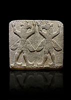 Photo of Hittite relief sculpted orthostat stone panel of Herald's Wall Basalt, Karkamıs, (Kargamıs), Carchemish (Karkemish), 900-700 B.C. Bird-headed, winged figures of human body. Anatolian Civilisations Museum, Ankara, Turkey.<br /> <br /> These figures are called as &quot;Winged Griffin Demons&quot;. Embossing is constructed symmetrically. Their hands are on their heads. It is assumed that they carry the heavens. <br /> <br /> Against a black background.