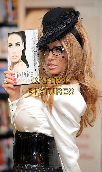 JORDAN - KATIE PRICE.Katie Price signs copies of her new book 'You Only Live Once' at Waterstone's, Piccadilly, London, England..October 28th, 2010.half length blouse silk satin cuffs black wide belt patent side glasses black hat veil white blonde hair.CAP/WIZ.© Wizard/Capital Pictures.