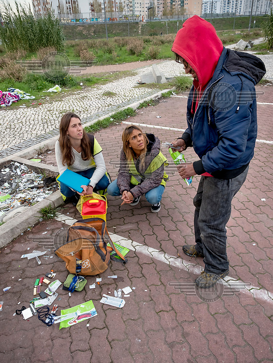 Social workers Andreia Alves and Rita Lopes collect used syringes, and other waste related to drug use, and distribute new kits containing new syringes and other material to drug users in the Lumiar neighbourhood.
