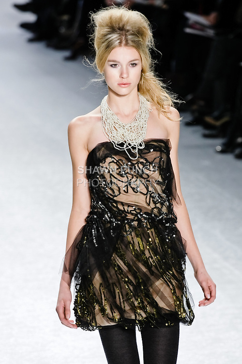 Keke Lindgard walks runway in a charcoal and olive sequin tulle draped dress at  the Vera Wang Fall 2010 fashion show during Mercedes-Benz Fashion Week.