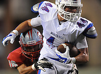 STAFF PHOTO ANDY SHUPE - Midland Christian's Kaleb Warren carries the ball as Highland defensive back Kevin French defends during the first half of play Monday, Sept. 1, 2014, at Razorback Stadium in Fayetteville.