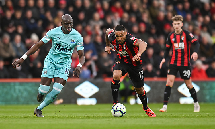 Bournemouth's Callum Wilson (right) under pressure from Newcastle United's Mohamed Diame (left) <br /> <br /> Photographer David Horton/CameraSport<br /> <br /> The Premier League - Bournemouth v Newcastle United - Saturday 16th March 2019 - Vitality Stadium - Bournemouth<br /> <br /> World Copyright © 2019 CameraSport. All rights reserved. 43 Linden Ave. Countesthorpe. Leicester. England. LE8 5PG - Tel: +44 (0) 116 277 4147 - admin@camerasport.com - www.camerasport.com