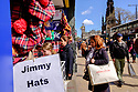 "Edinburgh, UK. 15.04.2017. People look at a shop selling ""Jimmy Hats"" on Princes Street. Photograph © Jane Hobson."