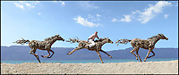 BNPS.co.uk (01202 558833)<br /> Pic: JamesDoran-Webb/BNPS<br /> <br /> ****Please use full byline****<br /> <br /> Three horses galloping on Cebu beach, Philippines with James Doran-Webb riding one of them.<br /> <br /> These majestic horses galloping along a white sand beach may look real - but in fact they're made from thousands of pieces of driftwood salvaged from beach.<br /> <br /> The life-size sculptures are the work of British master craftsman James Doran-Webb and took a painstaking six months to assemble.<br /> <br /> They stand at around 6ft tall - or 16 hands in horse terms - and each is made from 400 pieces of driftwood of varying sizes built around a stainless steel skeleton.<br /> <br /> They weigh half a tonne each once complete and can take the weight of five people.<br /> <br /> James cleverly makes them with moveable limbs so they can be arranged into lifelike poses.<br /> <br /> The intricate trio of horses were constructed for the Gardens by the Bay in Singapore, a nature park similar to Cornwall's Eden project.