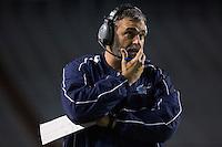 Arkansas Democrat-Gazette/MELISSA SUE GERRITS - 12/05/15 -  Har-Ber's Head Coach Chris Wood talks through his headphones in the 3rd quarter during their 7A Championship game against Fayetteville December 5, 2015 at War Memorial Stadium in Little Rock.
