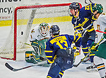 21 February 2015:  Merrimack College Warrior Forward Mathieu Tibbet, a Freshman from Dover, DE, is unable to score on University of Vermont Catamountn Goaltender Mike Santaguida, a Sophomore from Mississauga, Ontario, in first period action at Gutterson Fieldhouse in Burlington, Vermont. The teams played to a scoreless tie as the Cats wrapped up their Hockey East regular home season. Mandatory Credit: Ed Wolfstein Photo *** RAW (NEF) Image File Available ***