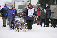 Jessie Royer walks her team to the start line on 4th avenue in Anchorage on Saturday March 1st during the ceremonial start day of the 2008 Iidtarod Sled Dog Race.
