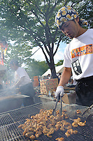 "Preparing barbecued intestines, B1 Grand Prix, Yokote, Akita Pref, Japan, September 19 2009. The B1 Grand Prix is a competition for inexpensive and tasty regional dishes from around Japan. The B stands for ""b-class gourmet"". In 2009 it was held in the northern Japan city of Yokote."