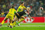 Australia play Canada in the Women's Rugby Sevens Cup Final on Day 1 of the Cathay Pacific / HSBC Hong Kong Sevens 2013 at Hong Kong Stadium, Hong Kong. Photo by Manuel Queimadelos / The Power of Sport Images