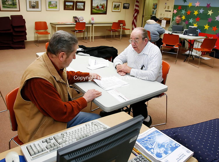 HARWINTON, CT, 02/10/08- 021009BZ04- John Rosenbeck, of Harwinton, right, gets help with his taxes from Peter Bronzi, of Torrington, an AARP Tax-Aide certified counselor, at the Harwinton Public Library Tuesday afternoon.   Volunteers offer income tax assistance by appointment on Tuesday's from 1 to 3 p.m. at the library.  The assistance is limited to personal income taxes and is available to taxpayers with middle and low incomes, with special attention to those aged 60 and over.<br /> Jamison C. Bazinet Republican-American