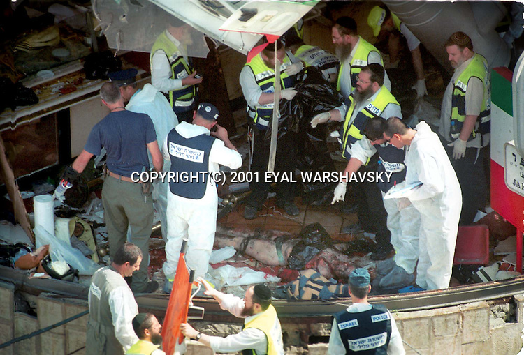 Israeli burial society check a body of  Israeli after a suicide bombing at a Jerusalem restaurant Thursday Aug 9 2001. PHOTO BY Eyal Warshavsky