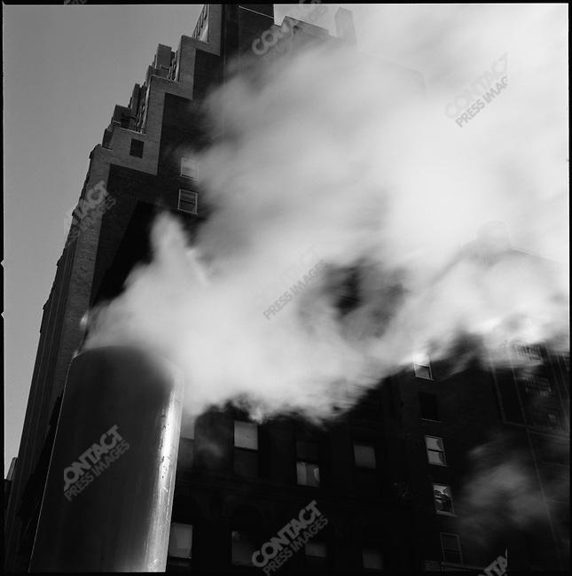 On Eight Avenue steam billowed from a street tube. New York City, New York, November 23, 2008