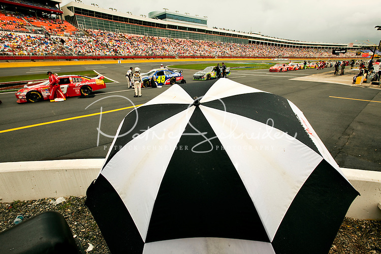NASCAR fans, the drivers and pit crews wait out the rain at the Lowe's Motor Speedway, in Concord, NC, during the 2009 Coca-Cola Classic 600 NASCAR race. Driver David Reutimann won his first Cup race during the rain-shortened event, held May 25, 2009. NASCAR's longest scheduled race went only 227 laps, or 340.5 miles, before officials ended it because of rain. The 2009 race was the 50th running of the Coca-Cola 600. Ryan Newman and Robby Gordon finished second and third respectively.