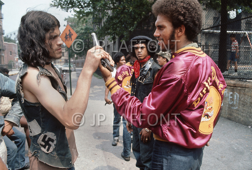 "New York, NY July 1972 - New York street gang ""Savage Skulls"". The trademark of the primarily Puerto Rican gang was a sleeveless denim jacket with a skull and crossbones design on the back. Based in the Hunts Point area of the  South Bronx, the gang declared war on the drug dealers that operated in the area. Running battles were frequent with rival gangs ""Seven Immortals"" and ""Savage Nomads"". Pictured is Savage Skull president FELIPE 'Blackie' MERCADO on the left"