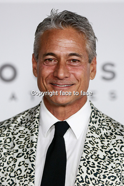 BEVERLY HILLS, CA - JANUARY 12: Greg Louganis arrives at the 71st Golden Globe Awards: Universal, NBC, Focus Features, E! sponsored by Chrysler viewing and after party held at The Beverly Hilton Hotel in Beverly Hills, CA on January, 12, 2014.<br />