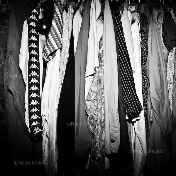 """WARSAW, POLAND, MARCH 2012:.Clothing items that are a part of """"freeshop"""" collection. The Freeshop is a place where people can leave unwanted clothes, while others can pick what they like for free. .(Photo by Piotr Malecki / Napo Images)..Warszawa Marzec 2012:.Zdjecie zrobione we """"freeshopie"""", czyli miejscu, gdzie mozna otrzymac za darmo niepotrzebne komus ubrania. Ten freeshop dziala w squacie """"Przychodnia"""" w centrum Warszawy, a od zdjec pozuje jeden ze studentow, ktorzy tu mieszkaja i prowadza ten """"sklep"""".Fot: Piotr Malecki / Napo Images"""