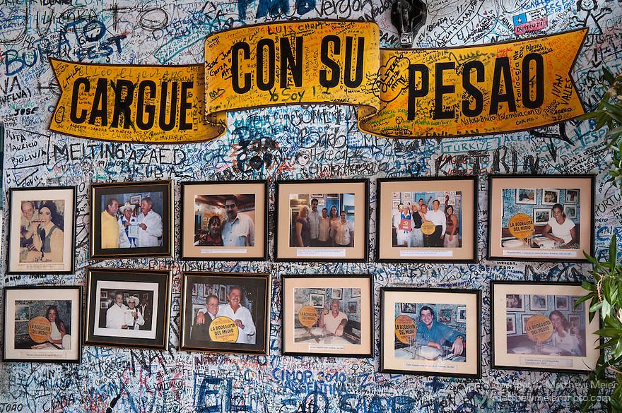 Havana, Cuba; a wall of photos at the bar at La Bodeguita del Medio, one of Ernest Hemingways favorite watering holes