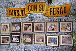 Havana, Cuba; a wall of photos at the bar at La Bodeguita del Medio, one of Ernest Hemingways favorite watering holes