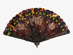 Brisé Fan (China), 1850–60; Carved tortoiseshell sticks, silk ribbon, tortoiseshell washer, metal loop; H x W (open); 23.5 x 39.4 cm (9 1/4 x 15 1/2 in.); Gift of Clarence Hoblitzelle, 1912-10-7; Cooper Hewitt, Smithsonian Design Museum;<br />