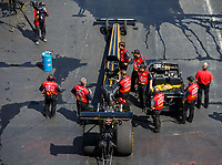Sep 16, 2017; Concord, NC, USA; Crew members surround the dragster of NHRA top fuel driver Leah Pritchett during qualifying for the Carolina Nationals at zMax Dragway. Mandatory Credit: Mark J. Rebilas-USA TODAY Sports