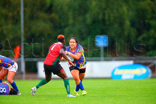 23.08.2015. Dublin, Ireland. Women's Sevens Series Qualifier 2015. Kenya versus Colombia<br /> Alejandra Betancur (Colombia) charges at Camilyne Oyuayo (Kenya).