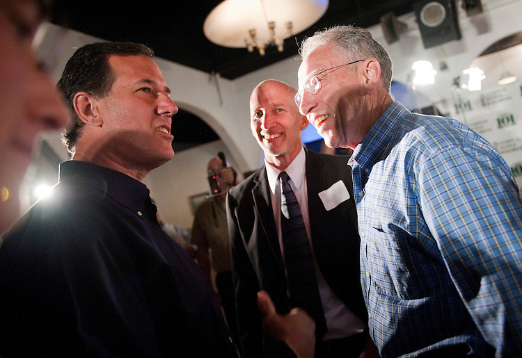 UNITED STATES - AUGUST 14:  Republican presidential candidate Rick Santorum, left, greets Sen. Chuck Grassley, R-Iowa, at the Lincoln Day Dinner hosted by the Black Hawk County Republican Party in Waterloo, Iowa.  Santorum, Texas Gov. Rick Perry, and Rep. Michele Bachmann, R-Minn., addressed the gathering.  (Photo By Tom Williams/Roll Call)