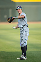 Logan Moon (12) of the Wilmington Blue Rocks warms up in the outfield prior to the game against the Winston-Salem Dash at BB&T Ballpark on June 10, 2015 in Winston-Salem, North Carolina.  The Blue Rocks defeated the Dash 11-5.  (Brian Westerholt/Four Seam Images)