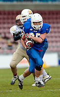 09 MAY 2010 - NORTHAMPTON, GBR - Birmingham Lions wide receiver Andy Watson looks for a way through the Loughborough Aces defence and to the end zone during the British Universities American Football Championship Final (PHOTO (C) NIGEL FARROW)
