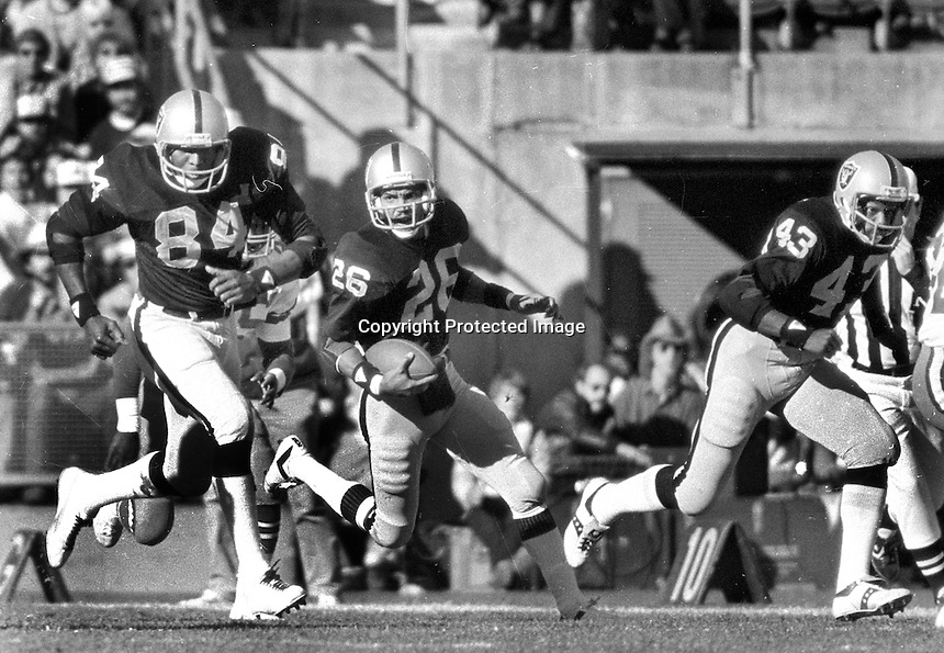 Raiders Keith Moody runing with blockers #84 Derrick Ramsey and #43 Ira Matthews.....(1980 photo/Ron Riesterer)