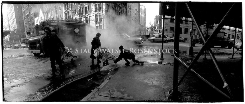 New York, NY - ConEd workers assist mothers with strollers on West End avenue during a Winter Watermain break,