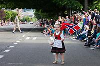 Little girl waving Norwegian Flag, 17th of May Parade 2016, Ballard, Seattle, WA, USA.