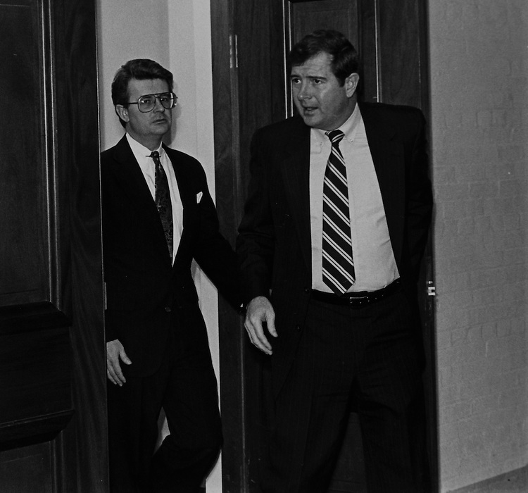 Ethics Committee members Rep. Fred Grandy, R-Iowa, and Rep. George Darden, D-Ga., leaving committee, during a closed session on January 28, 1991. (Photo by Chris Ayers/CQ Roll Call)