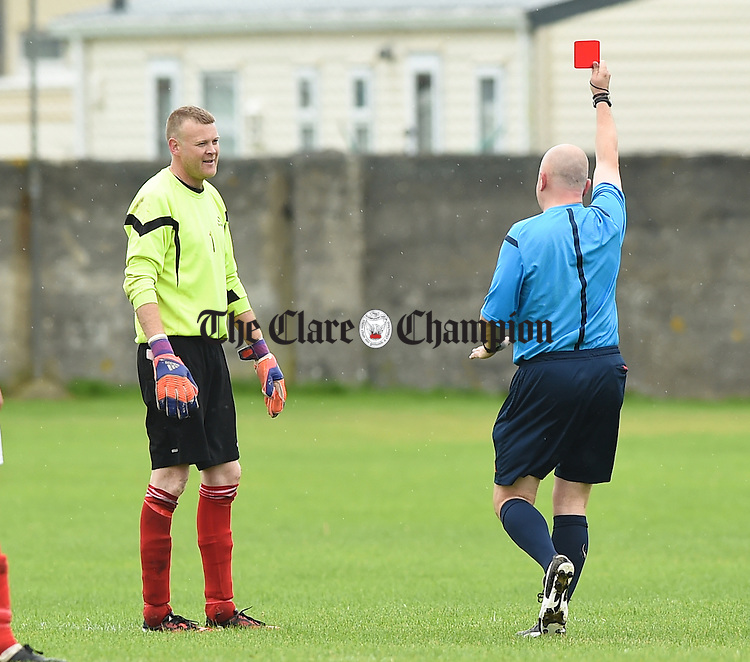 Goalie Trevor O Donnell of Newmarket Celtic gets sent off be referee Martin O Brien while playing Sporting Ennistymon during their Premier league game in Lahinch. Photograph by John Kelly.