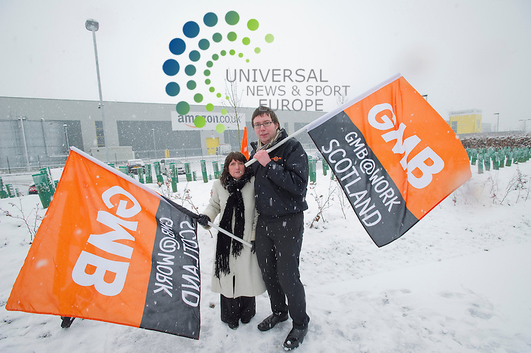 GMB officials gather outside Amazon, to demonstrate against what it claims are poor staff conditions and tax dodging by the firm, Glenrothes, Dunfermline, Fife, 13th February 2013.Picture:Scott Taylor Universal News And Sport (Europe) .All pictures must be credited to www.universalnewsandsport.com. (Office)0844 884 51 22.