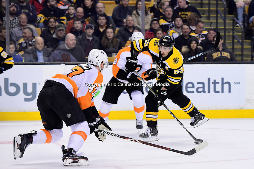 March 8, 2018: Boston Bruins left wing Brad Marchand (63) lines up his shot during the NHL game between the Philadelphia Flyers and the Boston Bruins held at TD Garden, in Boston, Mass. Boston defeats Philadelphia 3-2 in regulation time. Eric Canha/CSM