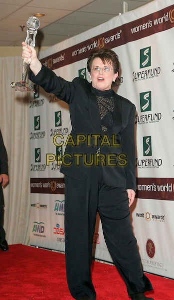 BILLIE JEAN KING.The 2006 Women's World Awards - Press Room held at the Hammerstein Ballroom, New York City, New York, USA, 14th October 2006..full length holding award trophy up arm raised.Ref: ADM/JL.www.capitalpictures.com.sales@capitalpictures.com.©Jackson Lee/AdMedia/Capital Pictures.