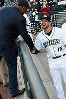 Columbia Mayor Steve Benjamin greets left fielder Tim Tebow (15) of the Columbia Fireflies in his first Class A game against the Augusta GreenJackets on Opening Day, Thursday, April 6, 2017, at Spirit Communications Park in Columbia, South Carolina. (Tom Priddy/Four Seam Images)