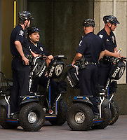 Charlotte Meckleburg Police Officers wait around on a Segway in uptown Charlotte, NC.